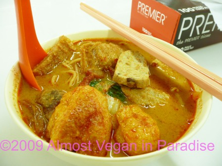 Hot and spicy curry laksa, with a box of tissues for the runny nose to follow