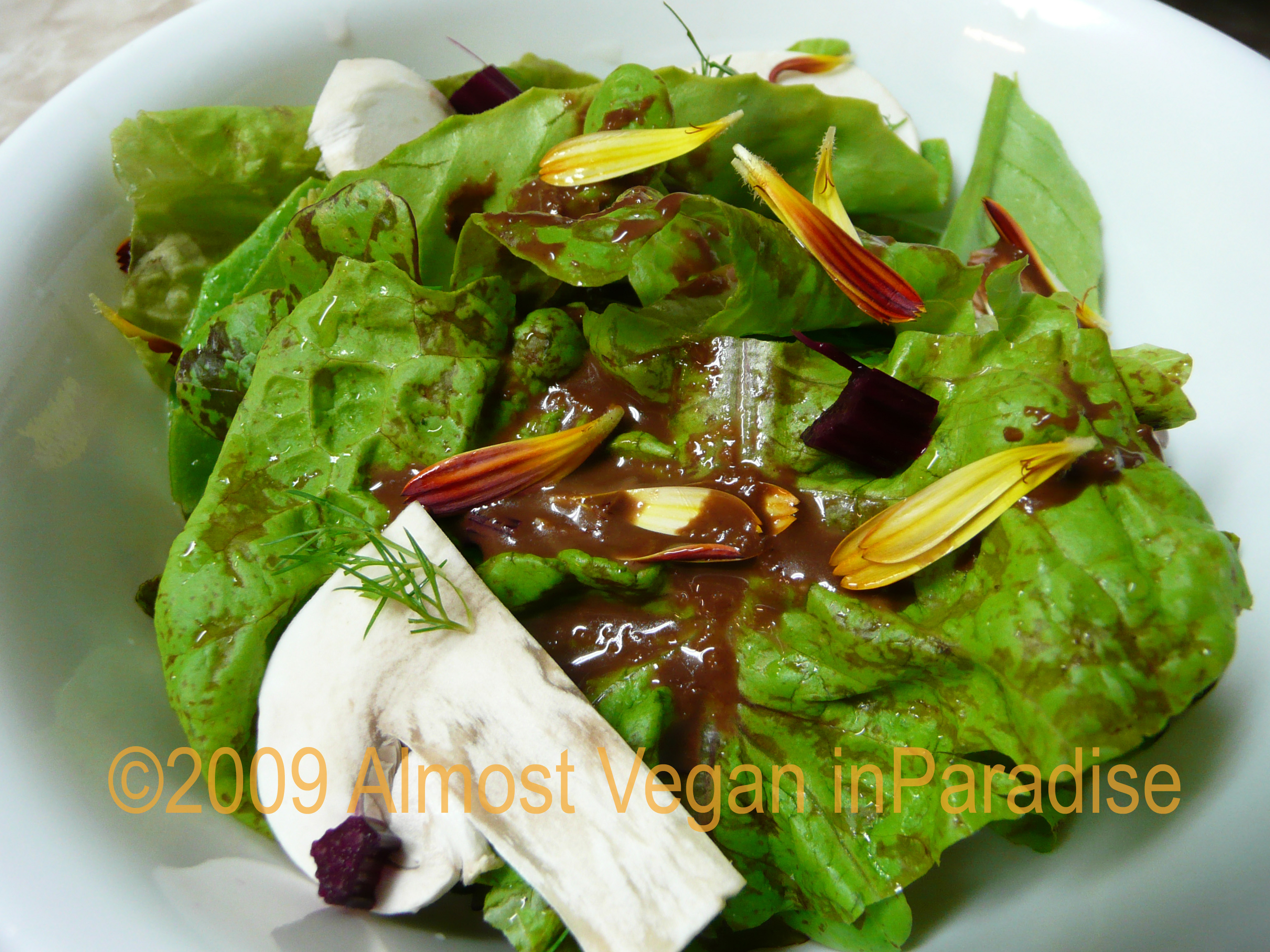 Organic garden greens with calendula petals and chocolate-miso dressing
