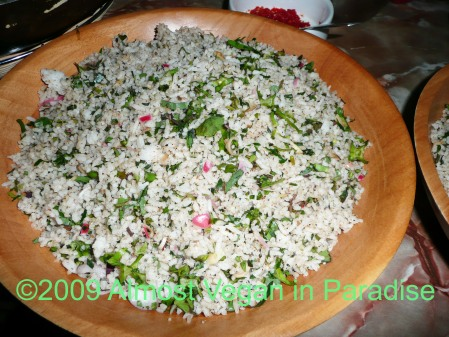 Vegan herbal rice with torch ginger flowers (the pink bits)
