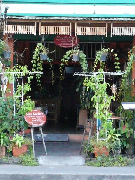 Look for the plants in front of the tiny shop.