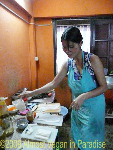 Duan prepares rice wrappers to make uncooked spring rolls.